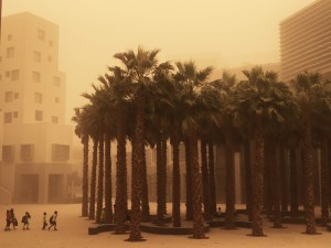 Emirati children visiting the NYU campus in Abu Dhabi navigate a major sandstorm 3 April 2015.