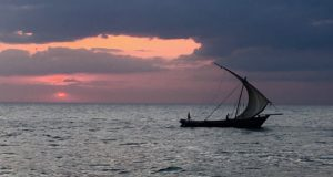 A dhow crosses Zanzibar bay 8 July 2016.
